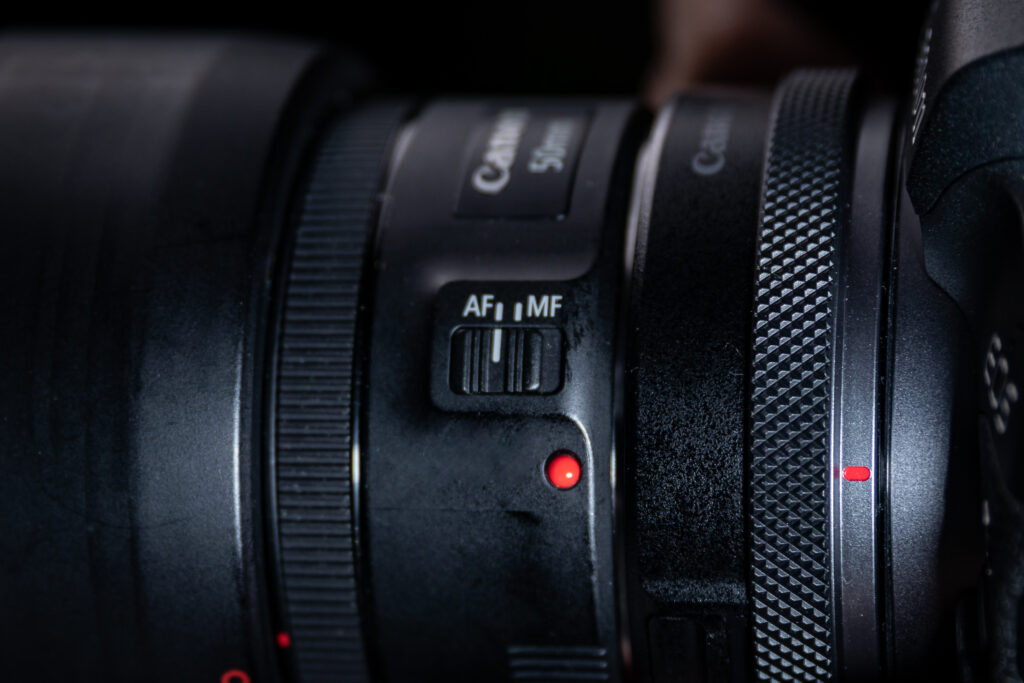 Image of a Canon camera lens featuring the AF-MF switch.
