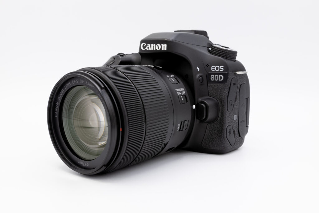 Image of a Canon 80D camera with a kit lens attached.