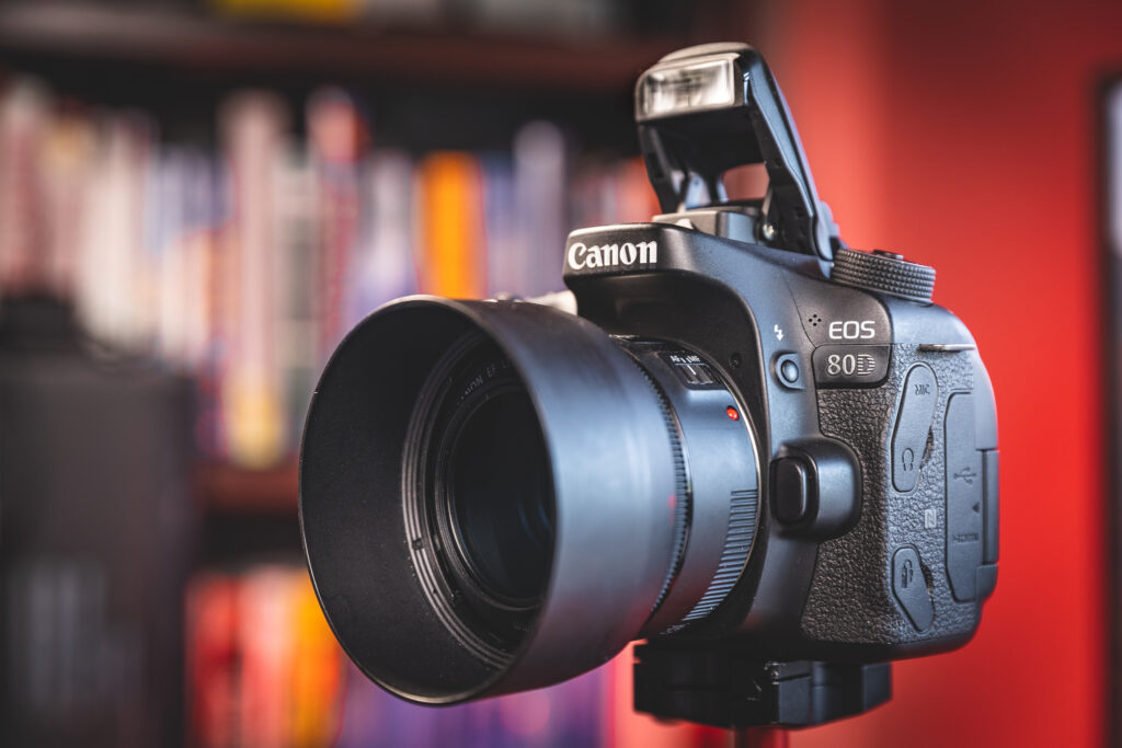 Image of a Canon 80D camera with pop-up flash enabled.