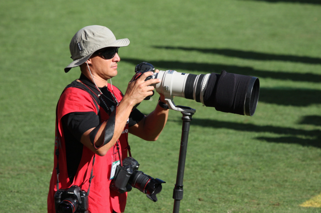 NFL Photographer with massive super telephoto lens and multiple cameras